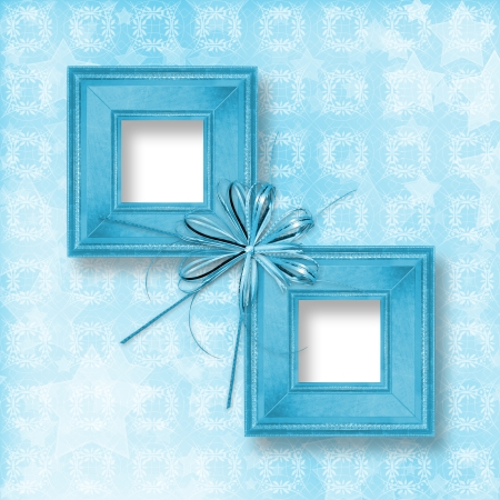 Old blue wooden frames Victorian style with bow and ribbons photo