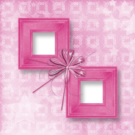 Old pink wooden frames Victorian style with bow and ribbons photo