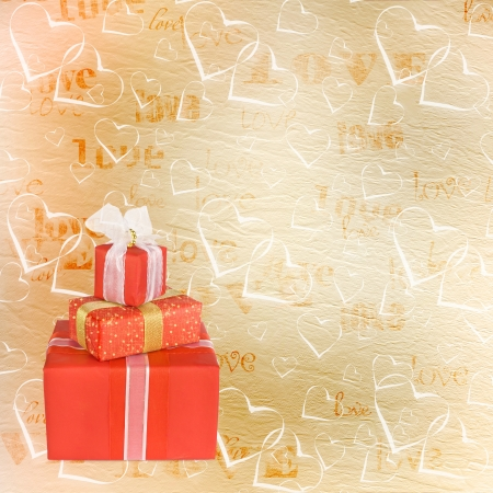 Holiday gift boxes decorated with bows and ribbons on the abstract background photo