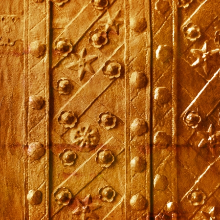 Old gold plate with a pattern of convex and star colors photo