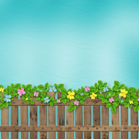 Wooden fence with a flower garland on the abstract background of a summer day Stock Photo - 14898292