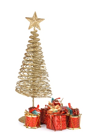Christmas greeting card with gold metal firtree and presents on the  isolated background photo