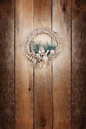 Christmas golden wreath on an old wooden door Stock Photo - 15899015