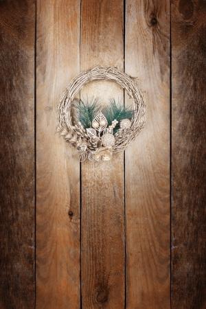 Christmas golden wreath on an old wooden door Stock Photo - 15899015