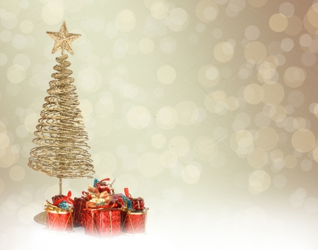christmastree: Christmas greeting card with gold metal firtree and presents on the abstract background Stock Photo