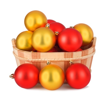 Wooden basket with a set of colorful Christmas balls isolated on white background Stock Photo - 16271413