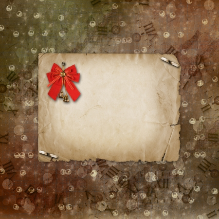 Christmas bells with red bow on the abstract background photo