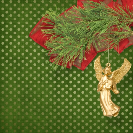 trumpery: Angel christmas hanging on the pine branch.  Stock Photo
