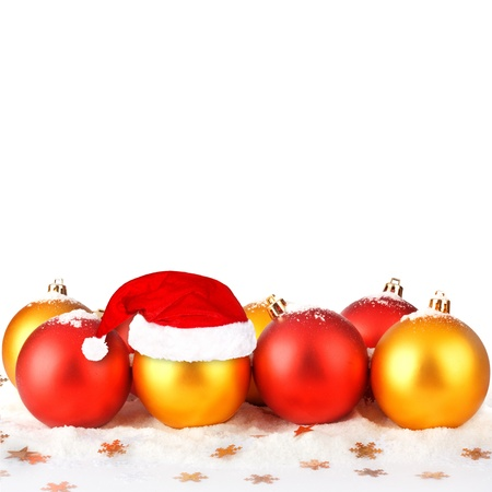 Christmas ball in the hat of Santa Claus  on the white isolated background Stock Photo - 16484421