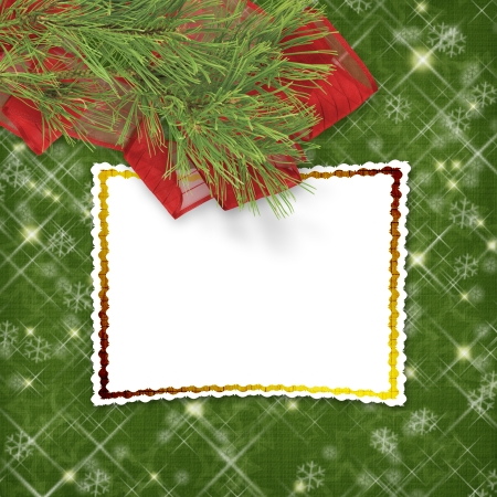 Christmas greeting card with firtree and frame on the  green abstract background photo