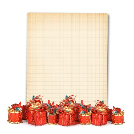 Christmas greeting card with heap gifts and vintage notebook on the white background photo