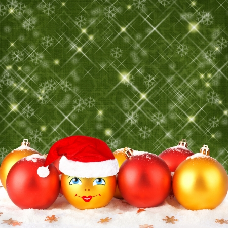 Christmas ball in the hat of Santa Claus  on the abstract background with stars photo