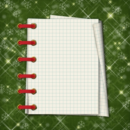 Christmas greeting card with notebook on the  green abstract background photo