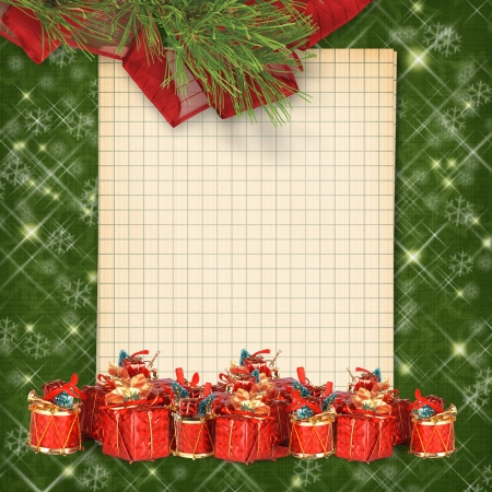 Christmas greeting card with presents on the  green abstract background photo