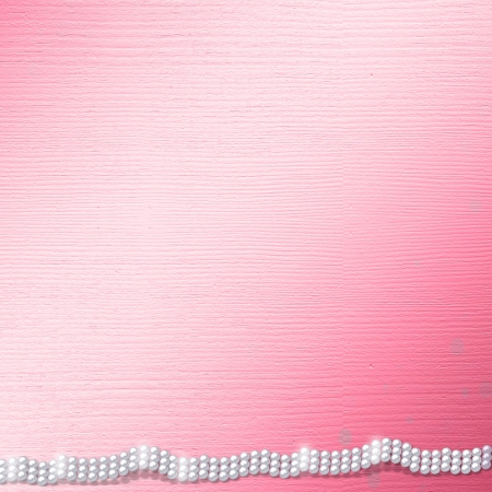 Pink card for invitation or congratulation with pearls  photo