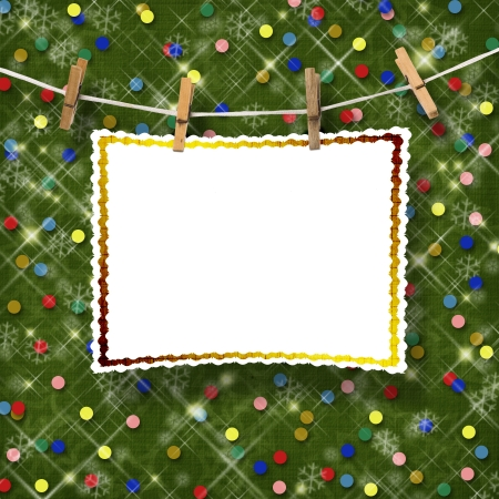 Greeting card hanging on a rope and clothespins  on the abstract sparkling background photo