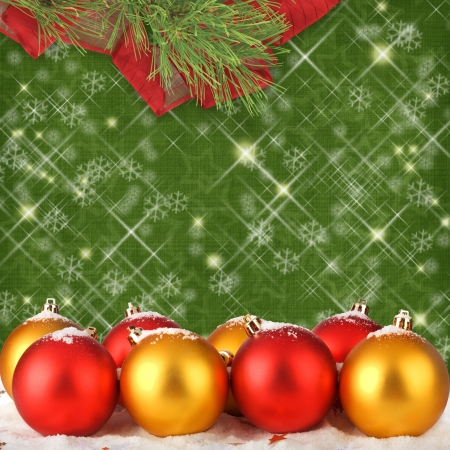 Christmas ball with pine branches on the abstract background photo
