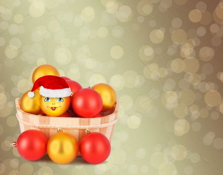 Christmas ball in the hat of Santa Claus  on the abstract background with blur boke photo