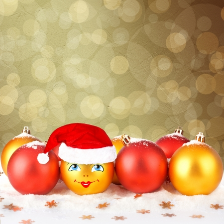 Christmas ball in the hat of Santa Claus  on the abstract background with blur boke Stock Photo - 16536227