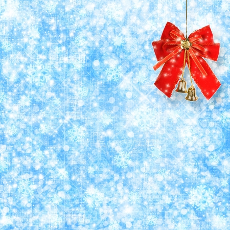 Abstract snowy background with snowflakes, stars and red bow photo