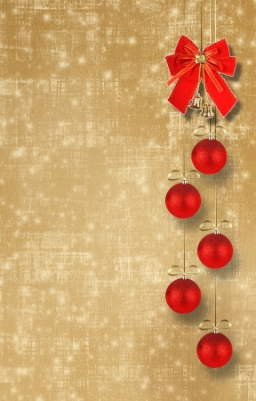 Christmas balls and red bow with bells on abstract snowy background photo