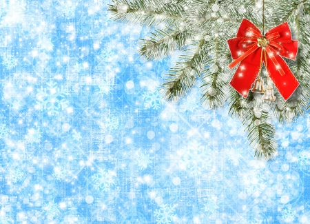 Christmas balls and red bow with bells on background snowy fir branches Stock Photo - 16584075