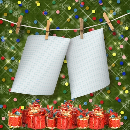 clothespeg: Greeting card hanging on a rope and clothespins  with presents on the abstract sparkling background