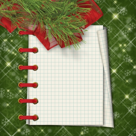 Christmas greeting card with firtree and notebook on the  green abstract background photo