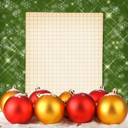 Christmas ball with notebook on the abstract sparkling background photo
