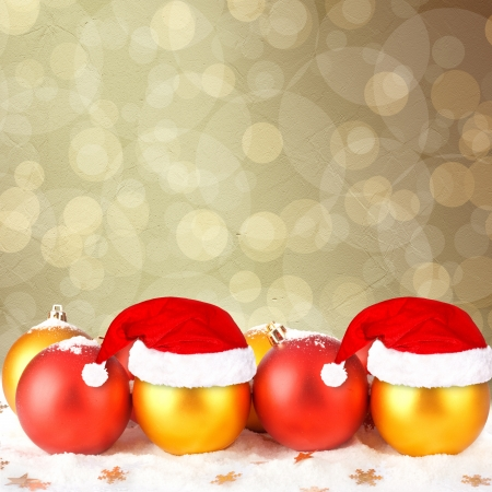 Christmas ball in the hat of Santa Claus  on the abstract background with blur boke Stock Photo - 16662967