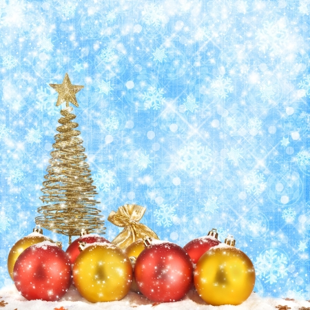 Christmas tree with balls and gift bags on snow background abstract photo