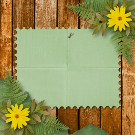 camomile flower: Grunge paper with bunch of flower on the wooden background Stock Photo
