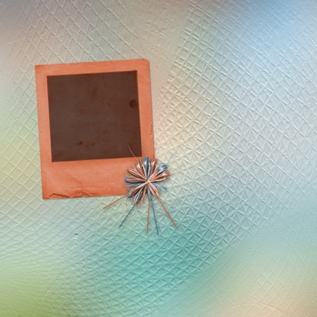 Paper used slide with bow on the grunge abstract background photo