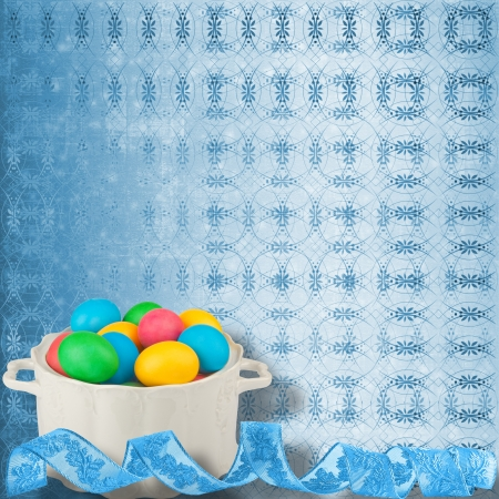 Pastel ornamental background with multicolored eggs in a bowl to celebrate Easter photo