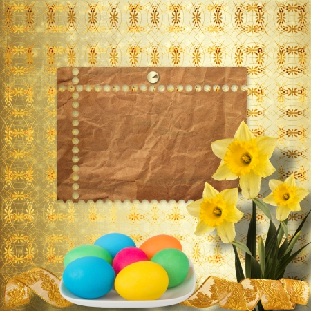 Pastel background with colored eggs and narcissus to celebrate Easter photo