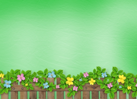 Wooden fence with a flower garland on the abstract background of a summer day  Stock Photo - 18722328