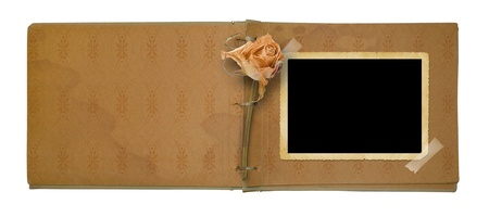 old photo album: Old photo album with beautiful dried rose isolated on a white background