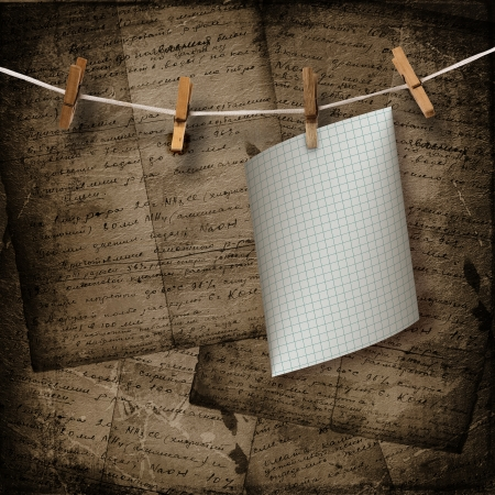 Old sheets hanging on a rope and clothespins on the brown abstract background  photo