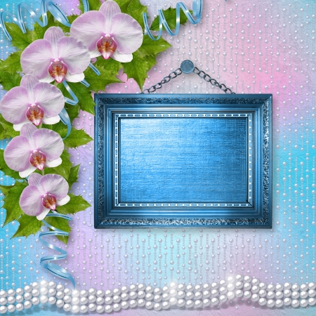 Wooden frames on the wall with branches of beautiful orchids for greeting card photo