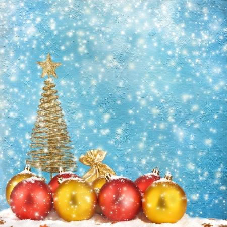 Christmas tree with balls and gift bags on snow background abstract Stock Photo