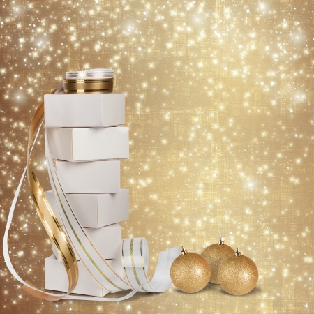 Christmas gifts and balls with gold ribbon on a beautiful abstract background photo
