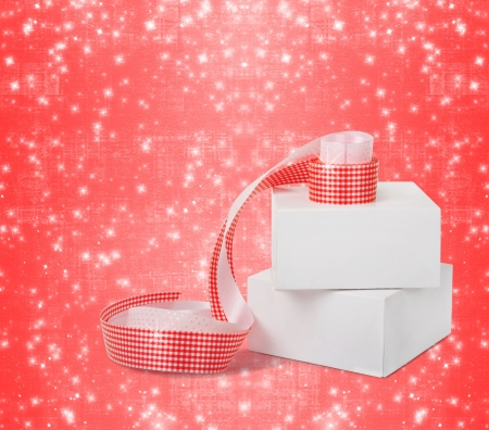 Gift boxes with red ribbons isolated on a white background photo