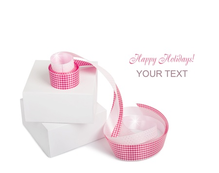 Gift boxes with pink ribbons isolated on a white background Stock Photo - 21637041