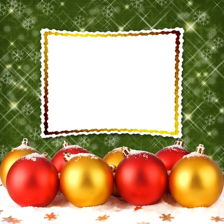 Christmas ball with greeting card on the abstract sparkling background photo