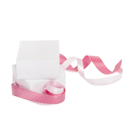 Gift boxes with pink ribbons isolated on a white background Stock Photo - 21948864