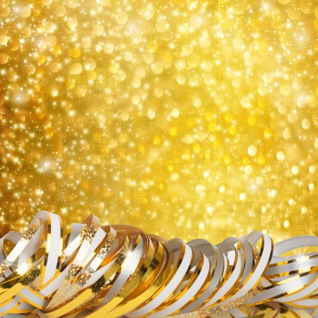 Gold paper horizontal ribbon on abstract snowy background fetti photo