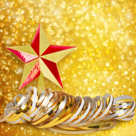 Gold paper horizontal ribbon and Christmas star on abstract snowy background  photo