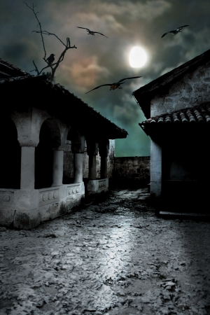Scary dark courtyard in the ominous moonlight night in a cold Halloween