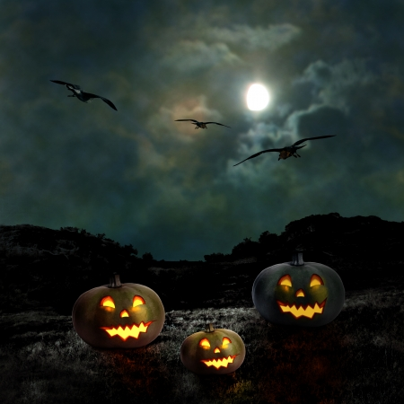 witch face: Halloween pumpkins in the yard of an old house at night in the bright moonlight