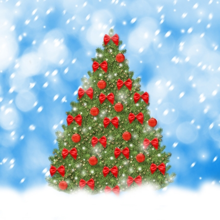 Christmas tree with red balls and beautiful bows on abstract snowy background photo
